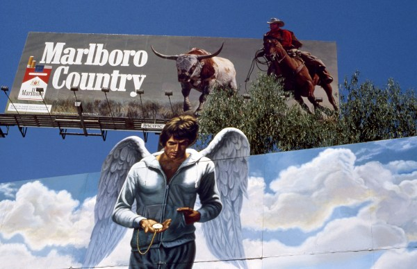 Warren Beatty in Heaven Can Wait billboard with Marlboro Cowboy overhead on the Sunset Strip circa 1979