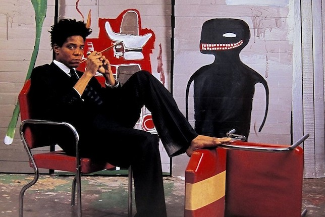 Jean-Michel Basquiat in his studio in 1985