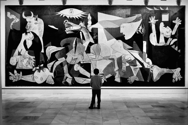 A child admiring Guernica by Pablo Picasso at the Reina Sofia Museum