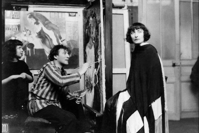 Chagall paints his wife, Bella (née Rosenfeld), as his daughter, Ida, watches.