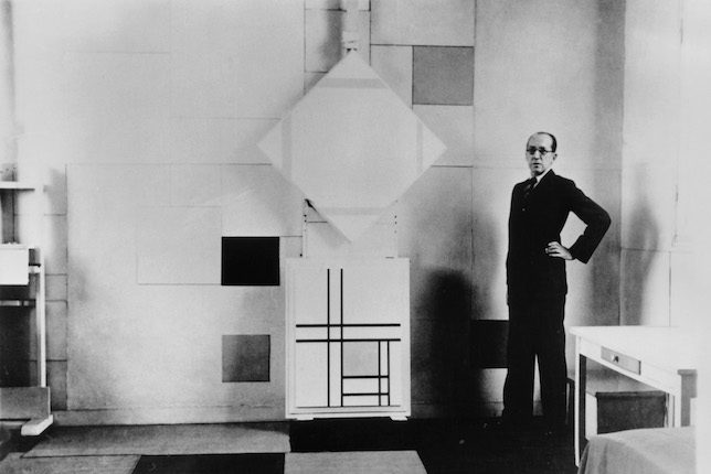 Piet Mondrian in his studio-home