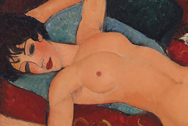 Lying naked woman on a couch painted by Amedeo Modigliani