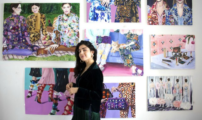Laura Gulshani photographed alongside some of her works