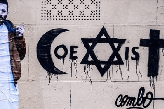 Combo coexist graffiti on a wall