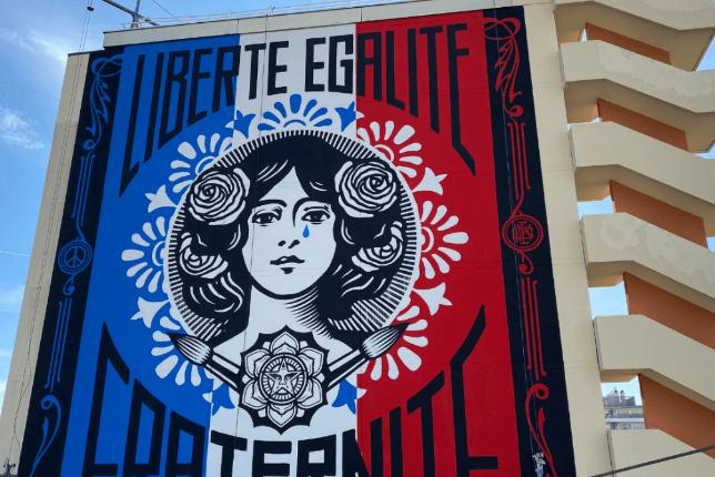 Shepard Fairey Marianne liberté égalité fraternité street art on side of building