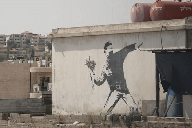 Banksy the flower thrower on wall